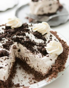 Cut out slice of No Bake Oreo Pie with Chocolate Graham Cracker Crust in a silver pie tray.