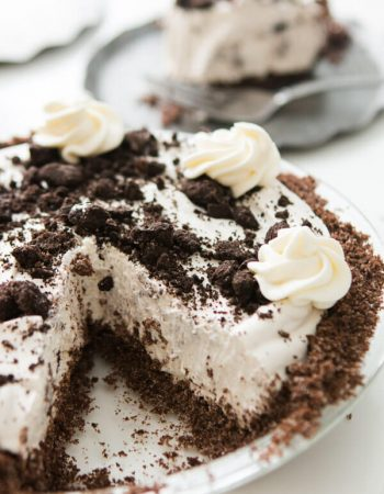 This is one of our most popular pie recipes and it's an easy pie recipe! Who wants a slice of no bake oreo pie with chocolate graham cracker crust?! ohsweetbasil.com