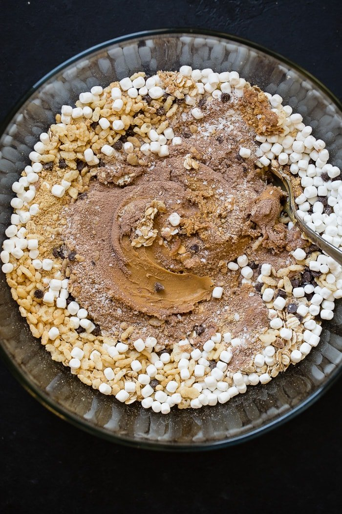 a bowl with the ingredients to make no bake protein s'mores energy bites