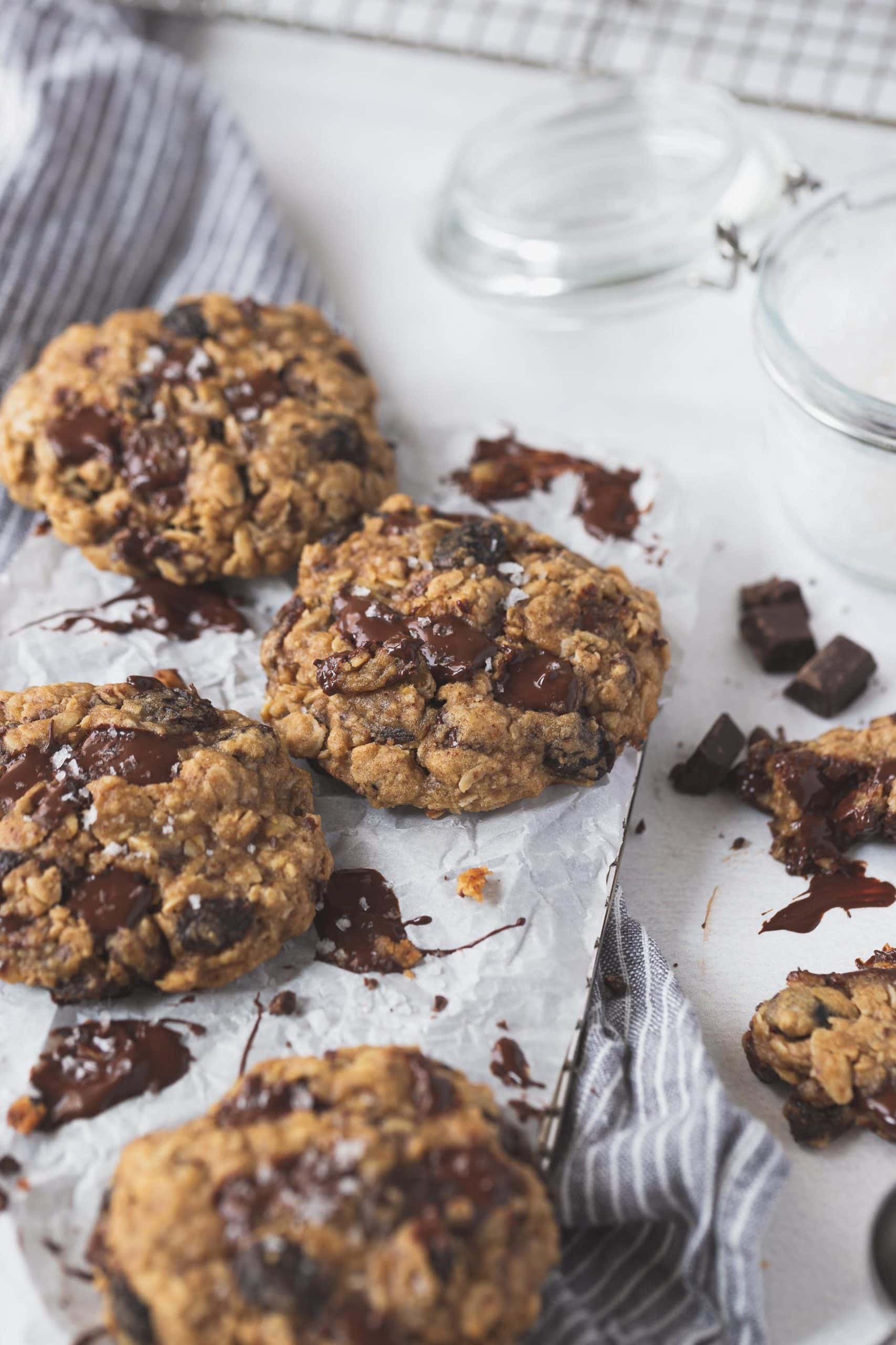 Oatmeal raisin chocolate chip cookies. There are raisins and chocolate chunks in and around the cookies.