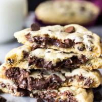 These fudge filled chocolate chip cookies are simple, classic chocolate chip cookies with a decadent chocolate fudge filling on the inside! These surprise-inside cookies are sure to be a new favorite! ohsweetbasil.com