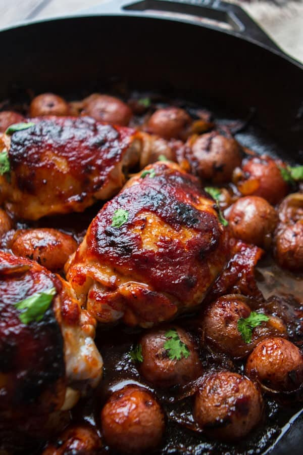 How I love easy, one skillet bbq chicken and potatoes for a make ahead dinner. Roasted potatoes, tender caramelized onions with the chicken, it's fantastic! ohsweetbasil.com