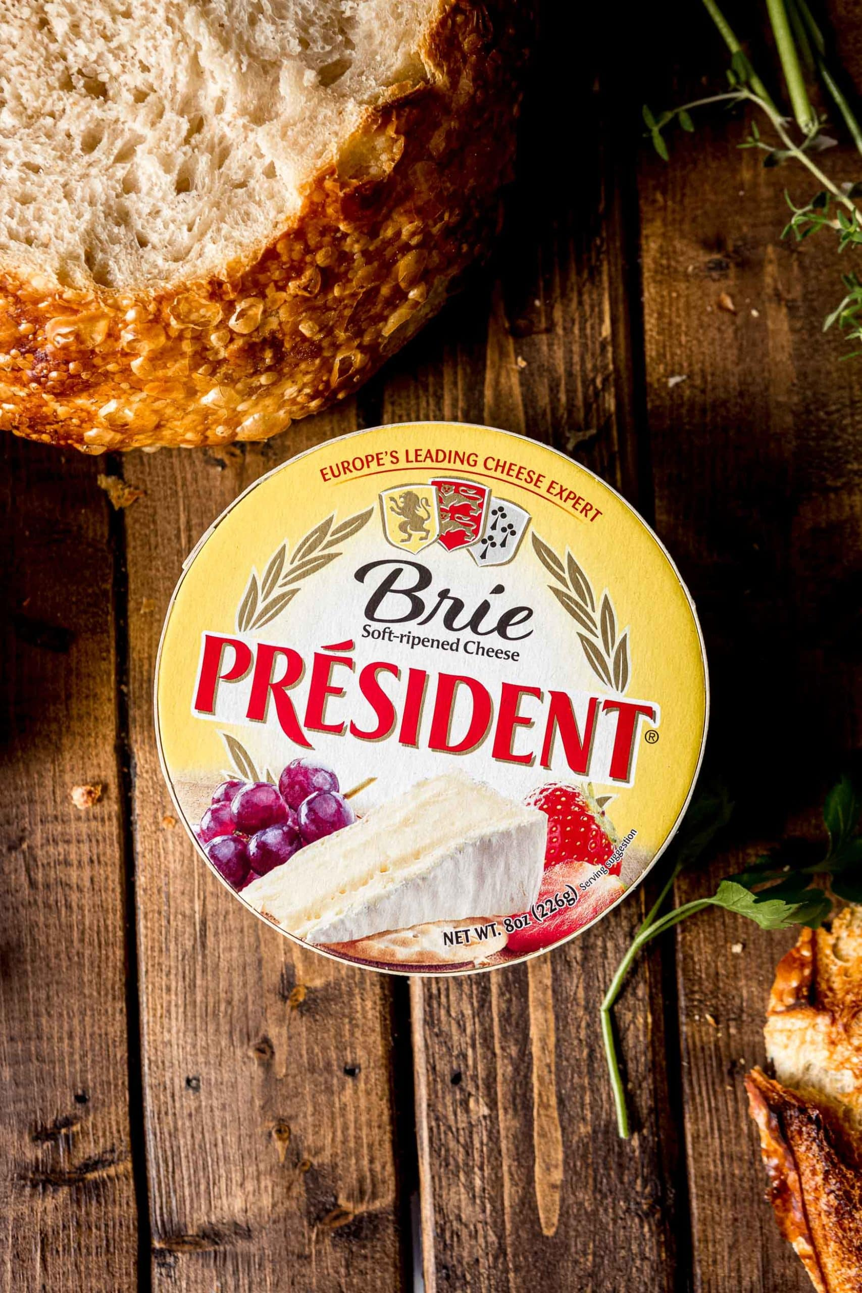 A wheel of President Brie still in the wrapper.
