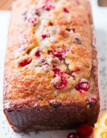 This Orange Cranberry Glazed Poppy Seed Bread is the perfect quick bread for if you want a whole loaf for the family or mini loaves for loved ones.