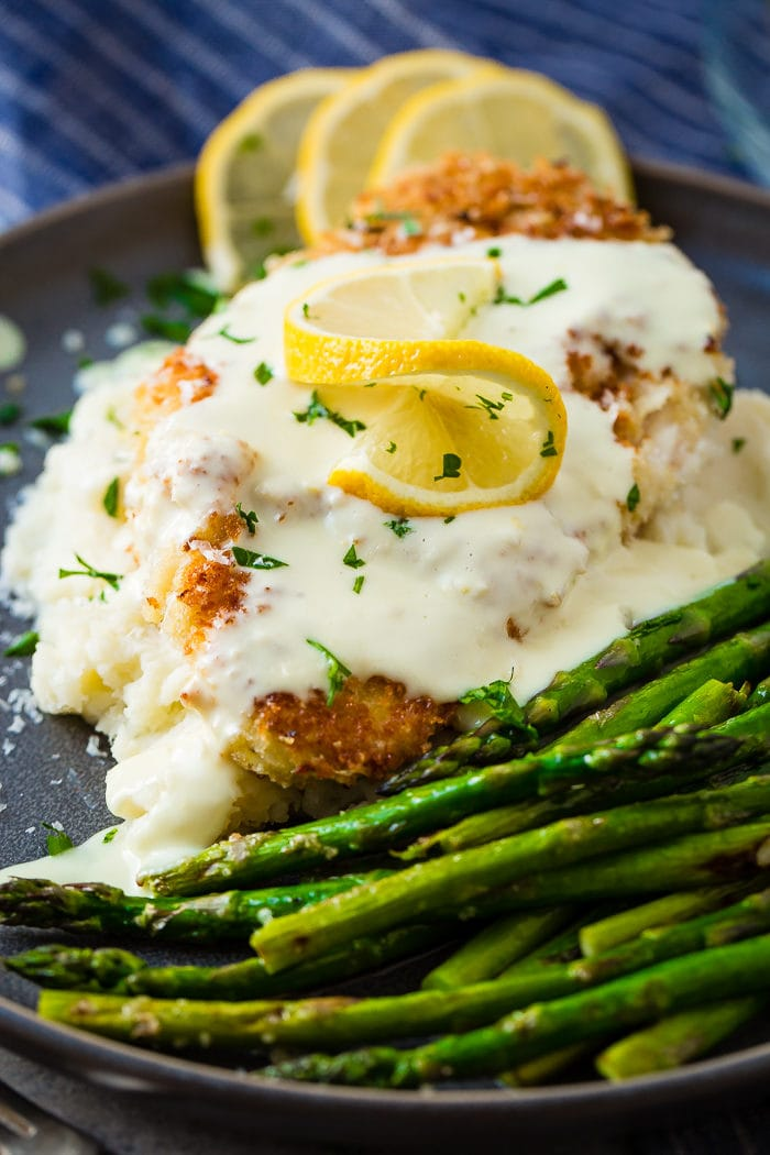 Panko Crusted Chicken with Lemon Cream Sauce and a bed of asparaguss