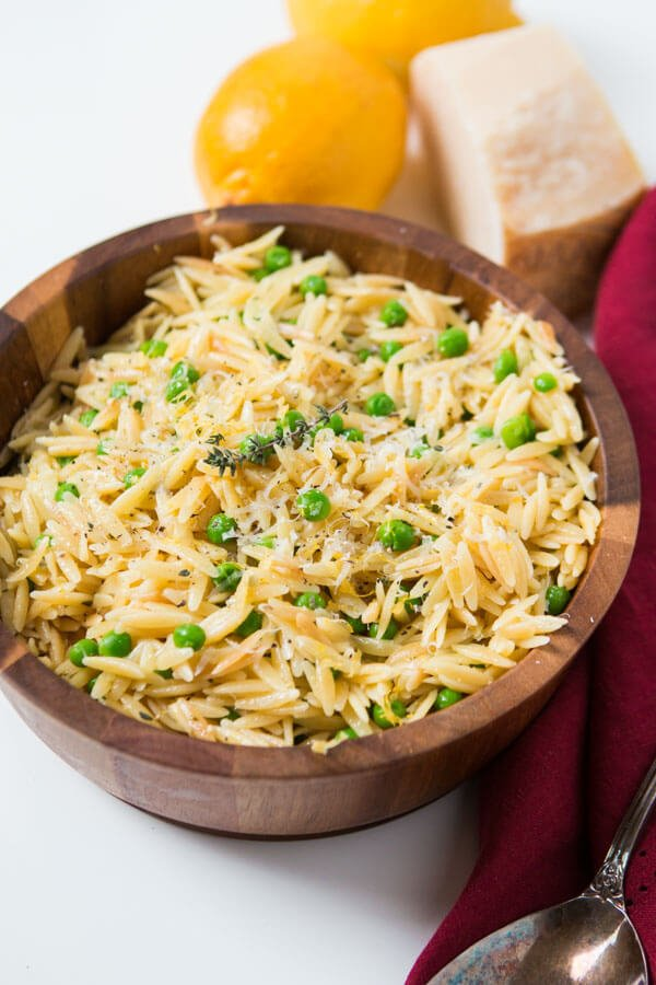 As the winter is starting to melt away we make recipes that scream spring like this Quick and easy lemon orzo with parmesan and peas. ohsweetbasil.com ohsweetbasil.com