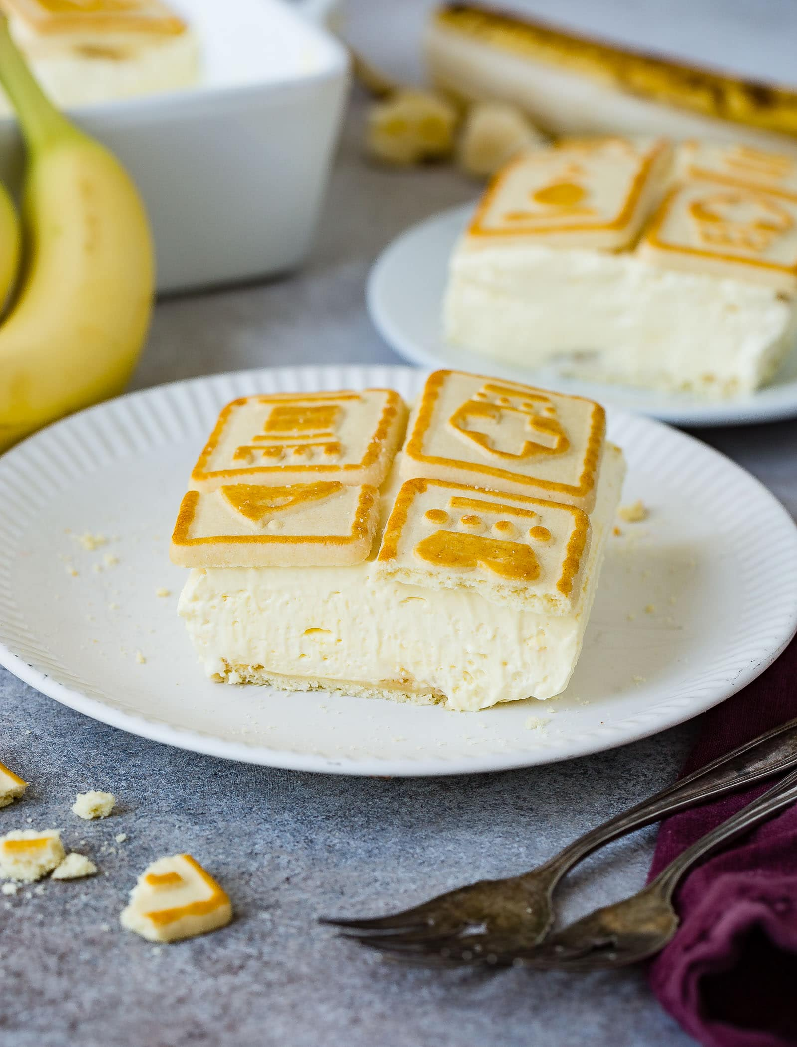 a slice of creamy banana cream pudding with chessman cookies on top