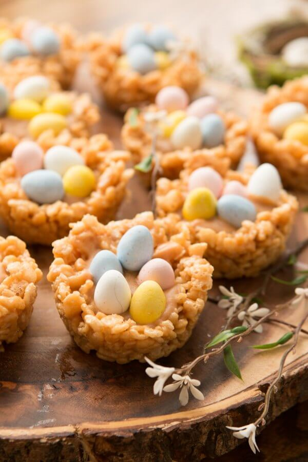 Spring is here! These beautiful Peanut Butter Rice Krispy Nests with Chocolate Eggs are as delicious as they are cute. Peanut butter chips, Rice Krispies, and Cadbury Eggs... what's not to love?!Peanut Butter Cream Filled Rice Krispy Nests with mini Cadbury Eggs ohsweetbasil.com Easter dessert, spring, no-bake