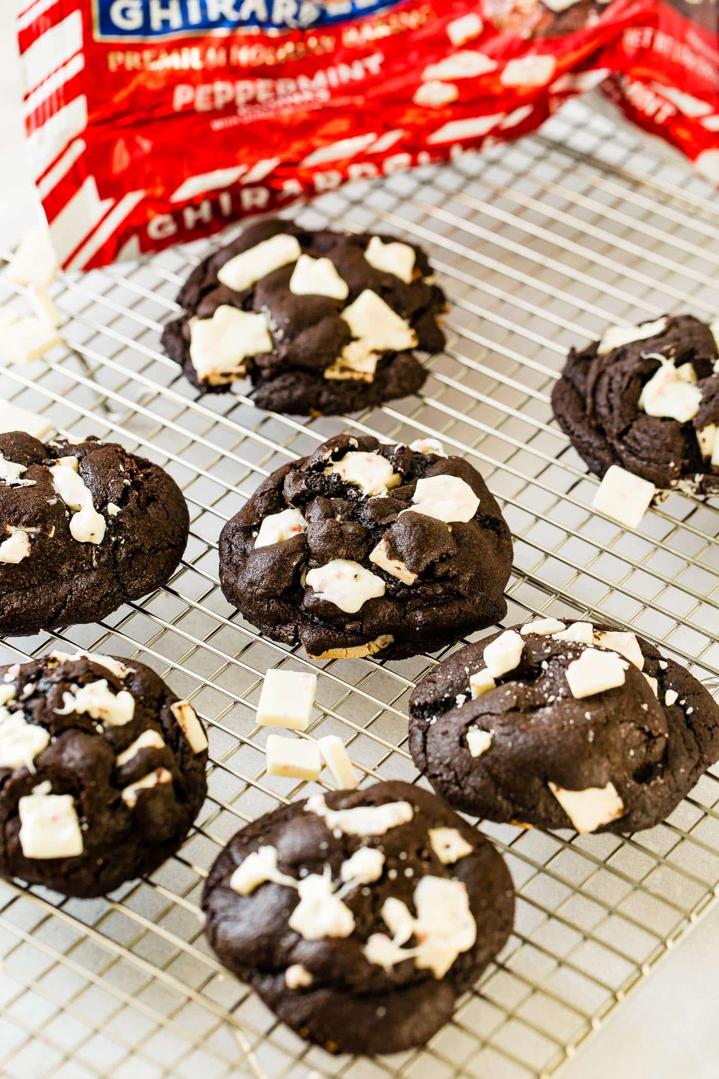 a cooling rack of dark chocolate peppermint bark cookies