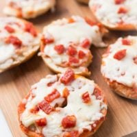 Listen, I'm not too fancy to admit that one of my favorite things as a kid were Pepperoni Bagel Bites Pizzas, and now we make them at home! ohsweetbasil.com