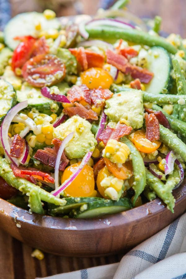 Every summer gardens everywhere are bursting with fresh produce ready to be harvested. Our favorite way to enjoy it is this Farmer John Pesto Garden Salad. ohsweetbasil.com