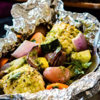 Want to know how to make foil packets for the grill? We love these pesto butter veggie foil packets for the grill as it can be hard to find good sides for bbqs and grilling. ohsweetbasil.com