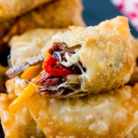 Who wouldn't love a crisp, fried egg roll full of meat and cheese? These Philly Cheesesteak Egg Rolls are perfect for football games and parties! ohsweetbasil.com