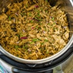 an instant pot full of shredded mexican poblano instant pot chicken