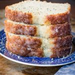 Glazed poppy seed bread is our family's go to for a delicious quick bread recipe to give out as neighbor gifts! ohsweetbasil.com