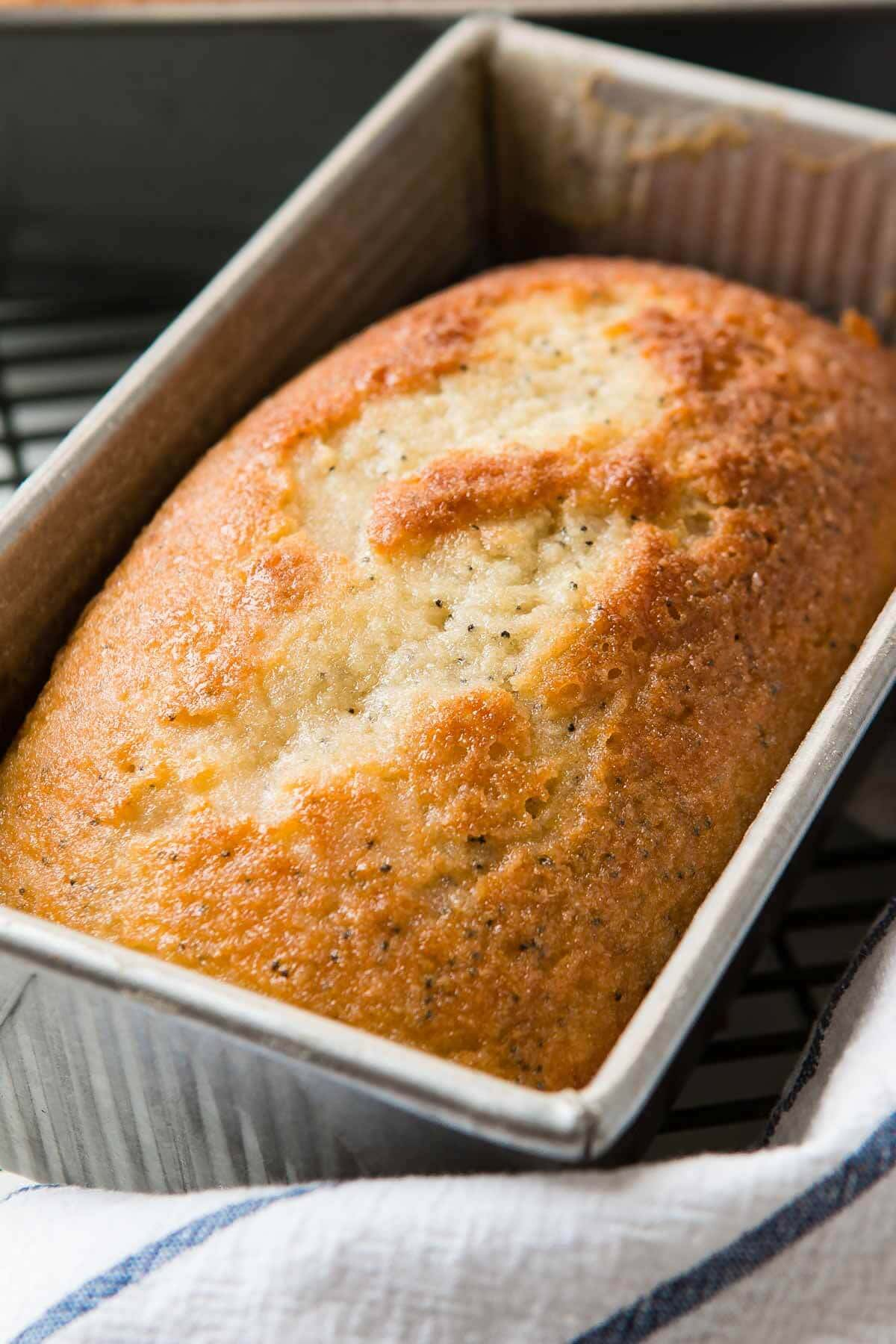 This lightly glazed poppy seed bread smells absolutely amazing while baking thanks to a few extracts that make your house smell more like home than it ever has before. ohsweetbasil.com