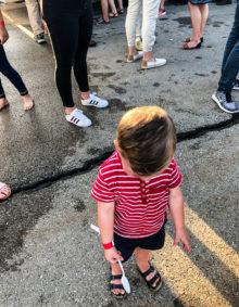 a little boy having a tantrum in public