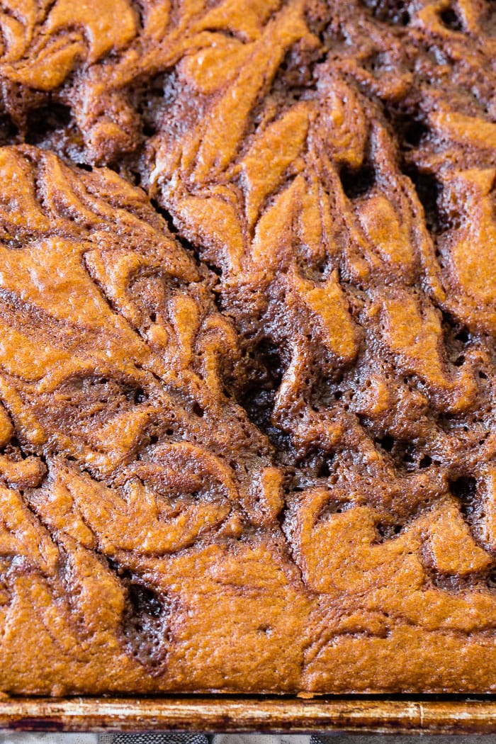 a close up of a slice of pumpkin cinnabon cinnamon roll sheet cake