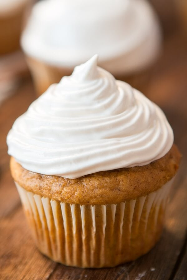 Pumpkin Cupcakes with 7-Minute Maple Frosting are perfect all fall and winter. The cake is tender and moist and the frosting is like marshmallow! ohsweetbasil.com