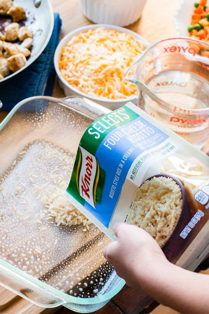 adding Knorr Selects risotto into a greased baking dish
