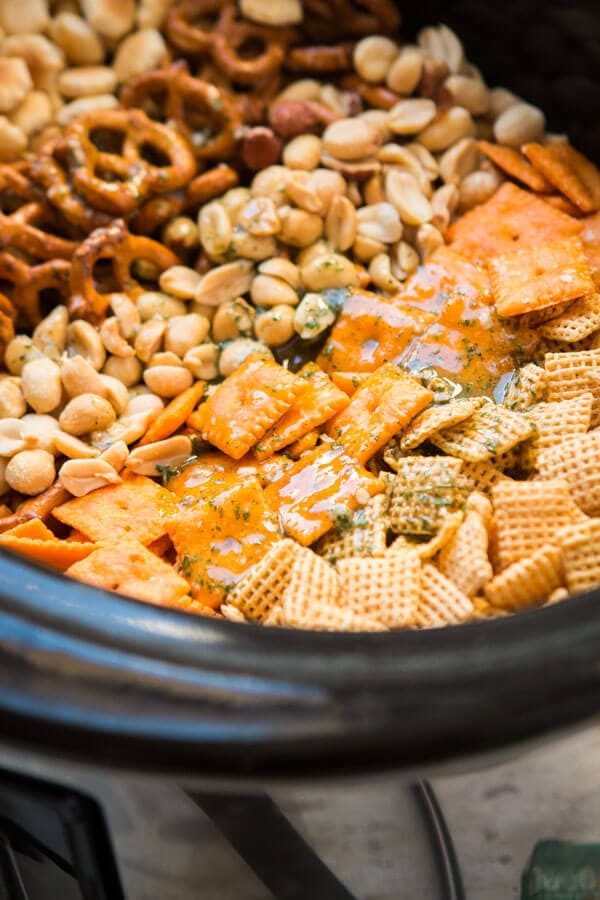 Every party needs something sweet, something salty, something light and something indulgent. This ranch slow cooker chex mix is both salty and addicting! ohsweetbasil.com