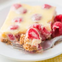 Lemon Raspberry Bars with a buttery graham cracker crust!
