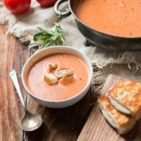 Roasted tomatoes make the best tomato soup ever! This roasted tomato basil soup with mini grilled cheese croutons is our current dinner obsession. ohsweetbasil.com
