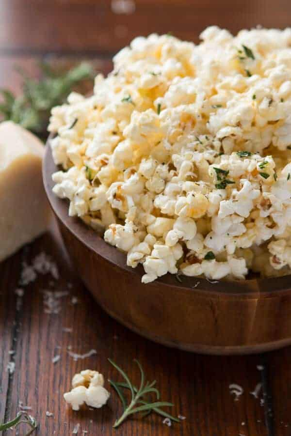 Everyone goes nuts for our Marshmallow Popcorn so it was high time to find the best savory popcorn recipe and this rosemary parmesan popcorn is it! ohsweetbasil.com