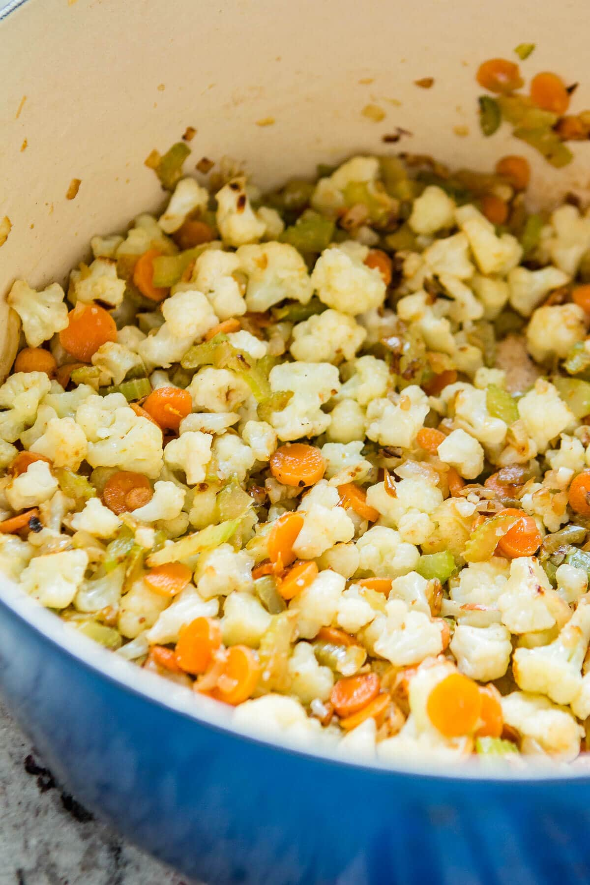 Start out by cooking the carrots, onion, celery and cauliflower until tender. Make sure you don't add the garlic until the very end to avoid burning. ohsweetbasil.com