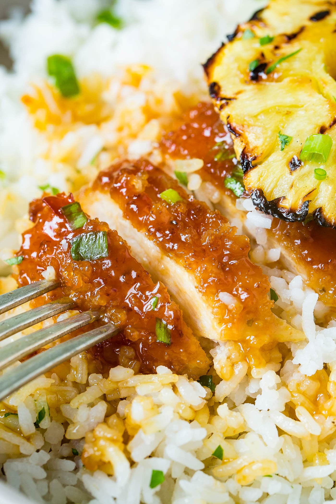 breaded chicken sticky sauce chicken like sweet and sour sauce then a beautiful piece of grilled pineapple on top