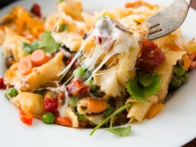 This is one of our favorite dinners, cheesy pan fried tortellini. It's fresh tortellini, sauteed vegetables, and gooey mozzarella cheese, simply delicious! ohsweetbasil.com