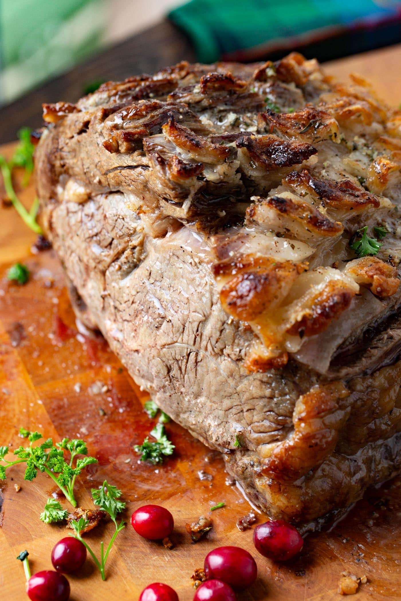 A photo a prime rib roast resting on a cutting board.