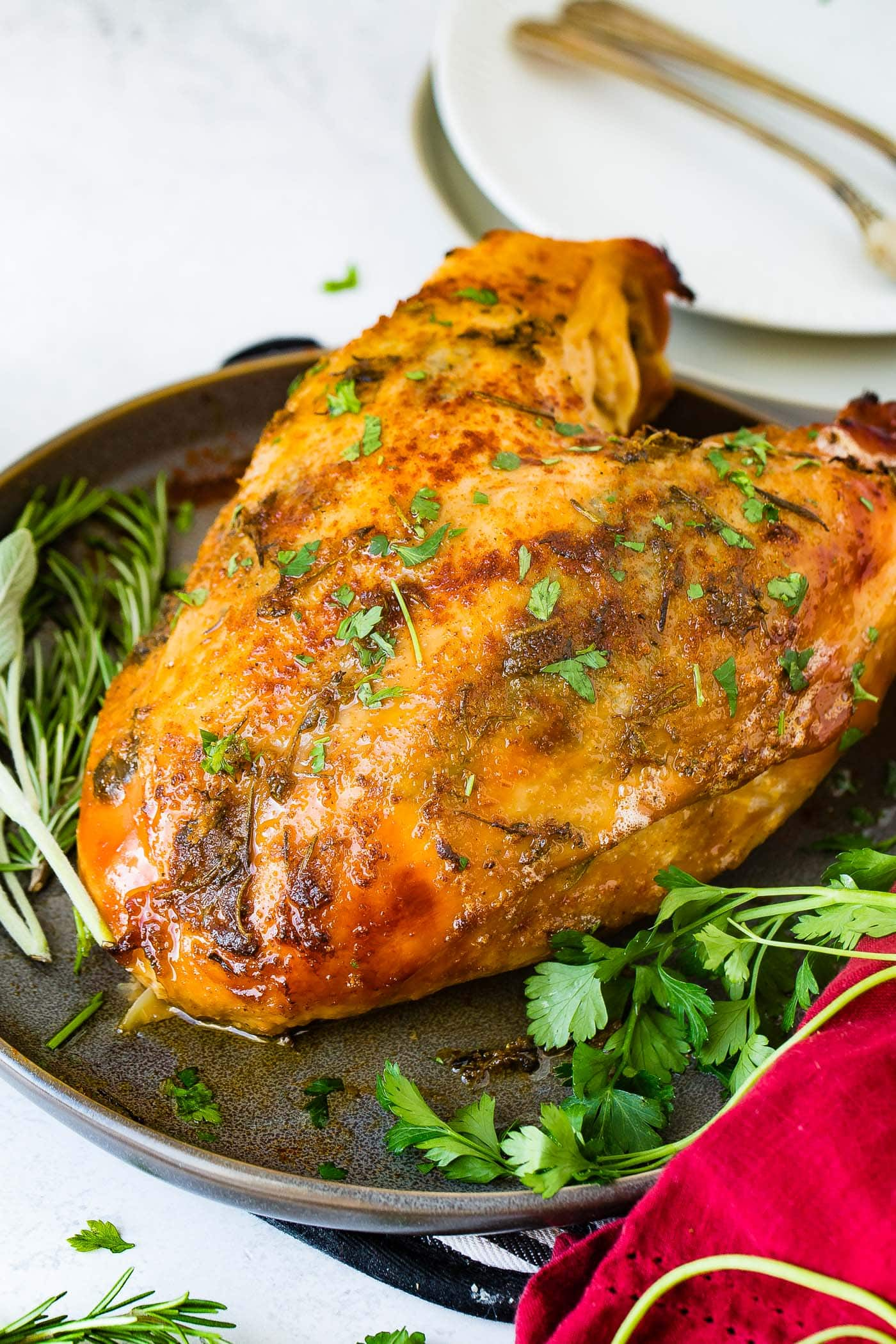 A photo of a double breasted slow cooker turkey breast perfectly golden and crispy.