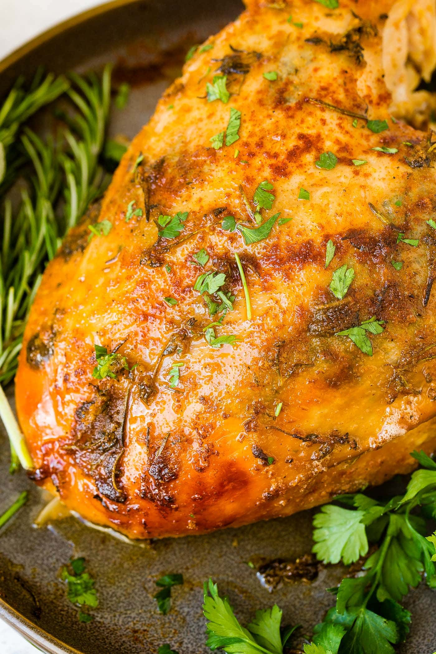 A close up photo of golden crispy slow cooker turkey breast.