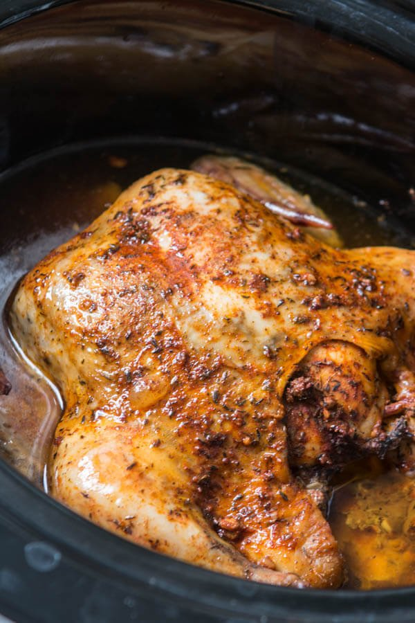 This is the easiest way to enjoy a juicy, rotisserie like chicken by only using a crockpot. Slow cooker whole chicken that anyone can make! ohsweetbasil.com