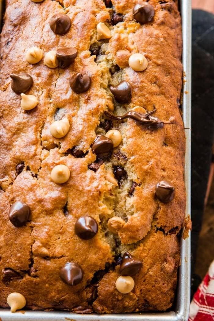 This peanut butter banana bread filled with little morsels of peanut butter and chocolate is the perfect solution to over ripe bananas ohsweetbasil.com