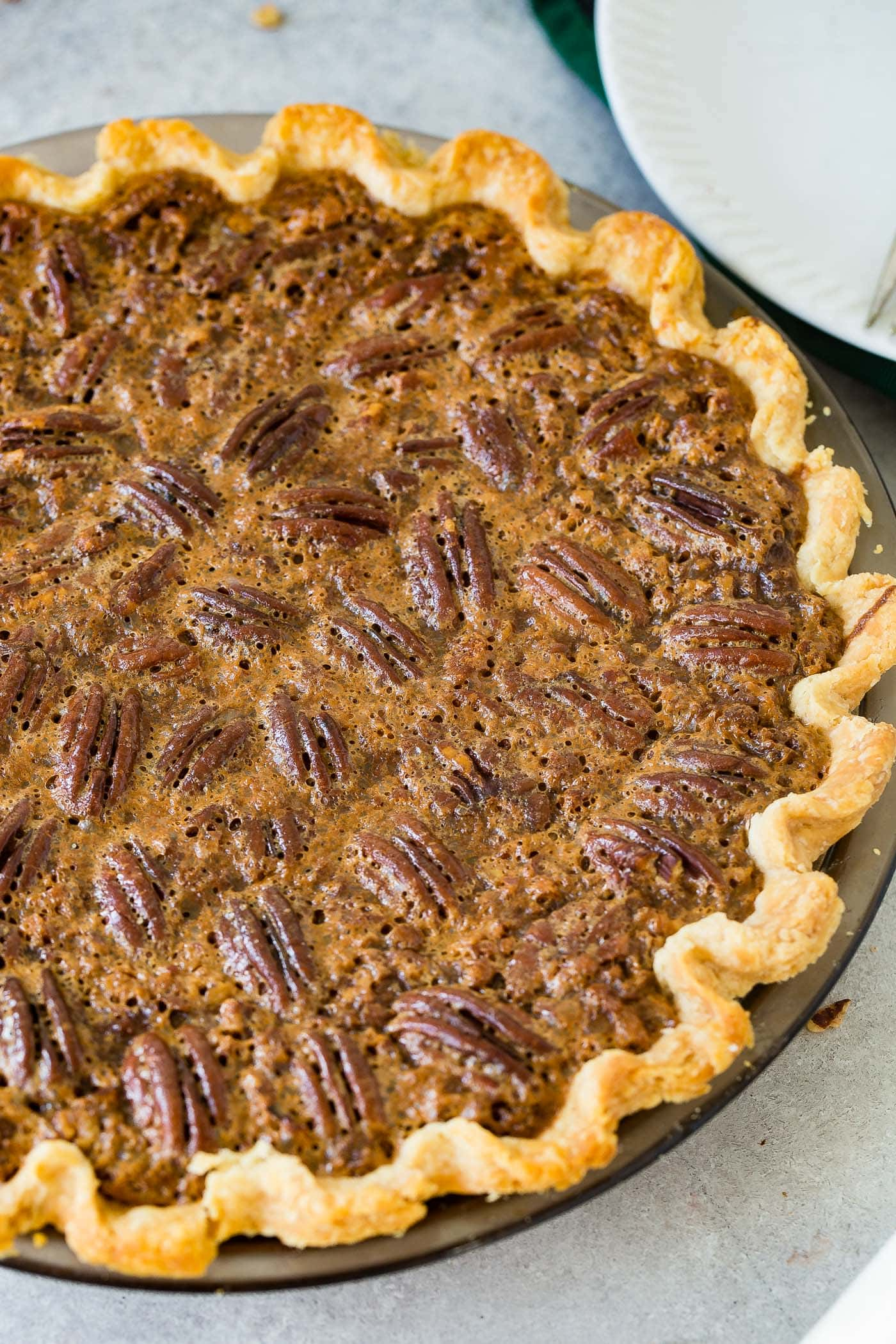 A photo of a whole pecan pie perfectly baked.