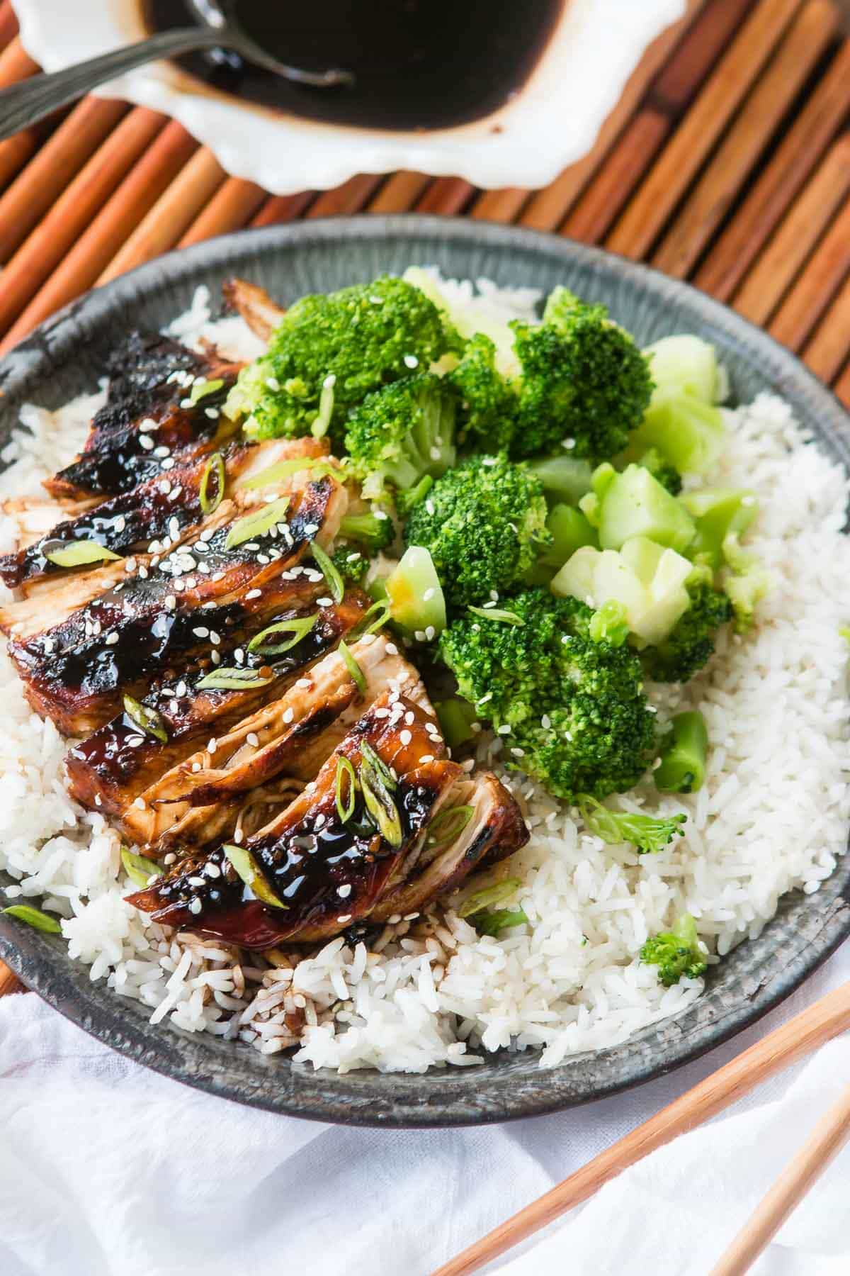 Need a really good recipe for Asian Chicken but don't want a crazy list of ingredients you don't have on hand? Here's Sticky Asian Grilled Chicken Breasts! Sticky Asian sauce made with soy sauce and sweet chili sauce served over chicken and rice ohsweetbasil.com