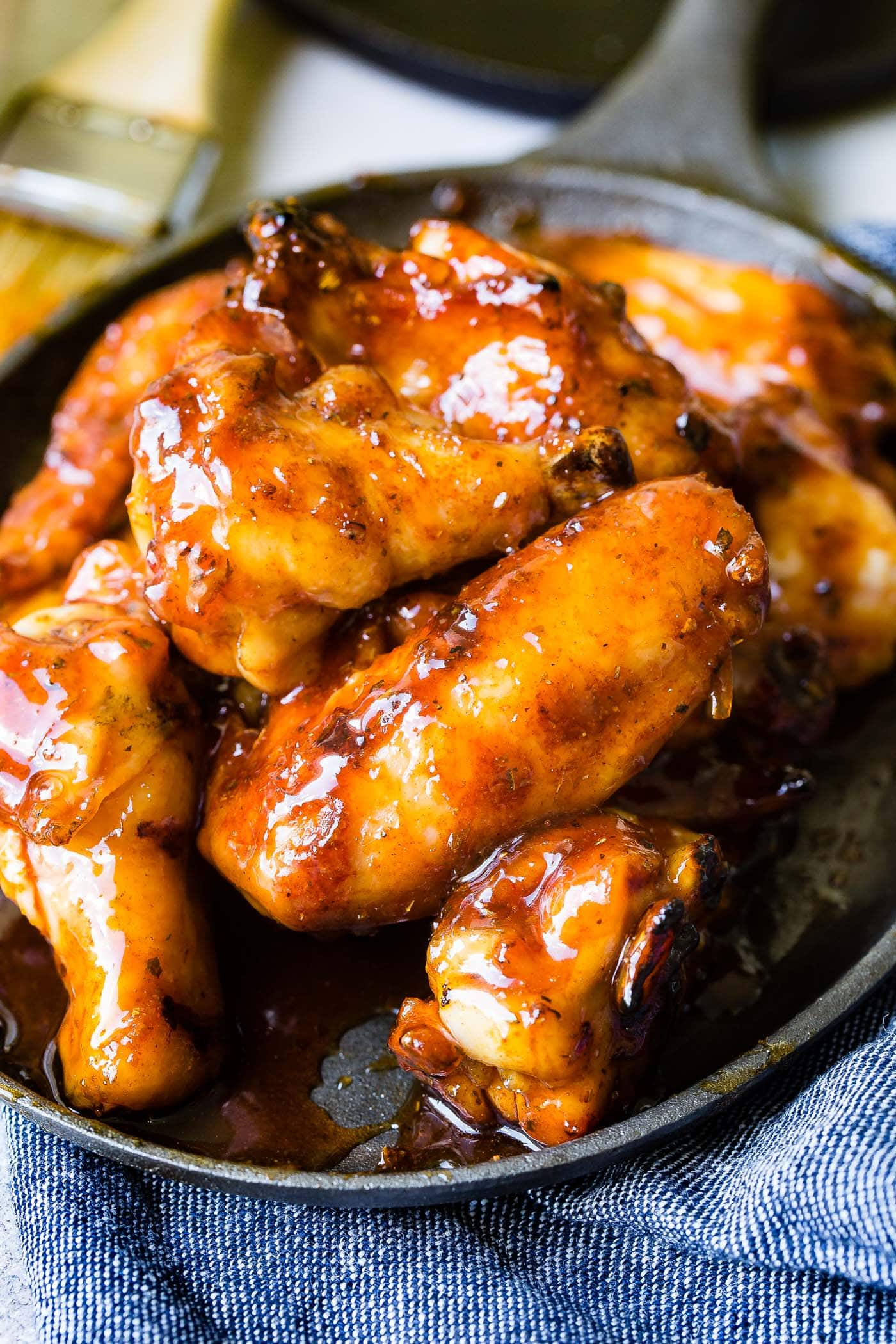 A photo of a plate full of glazed smoked chicken wings.