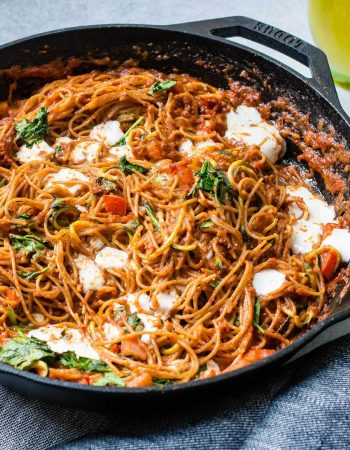 Whole wheat pasta and zucchini noodles swimming in a flavorful sun dried tomato pesto sauce with spinach and fresh mozzarella! ohsweetbasil.com