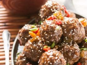 These sweet and sour meatballs are perfect for dinner or an appetizer for football parties. They can be baked in the oven or slow cooker! crock pot, insta-pot