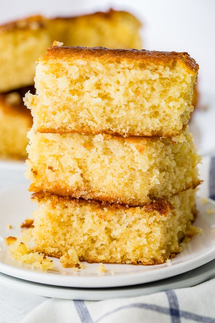 A photo of three pieces of sweet moist cornbread stacked on top of each other.