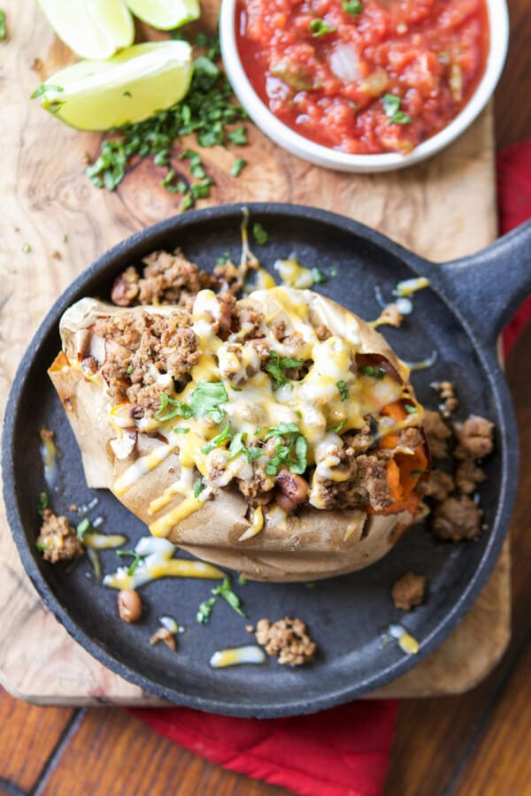 We love food, but we have to have balance and healthy dinners are essential. If you're looking for a healthy dinner idea try taco stuffed sweet potatoes. paleo, Whole 30, gluten free,