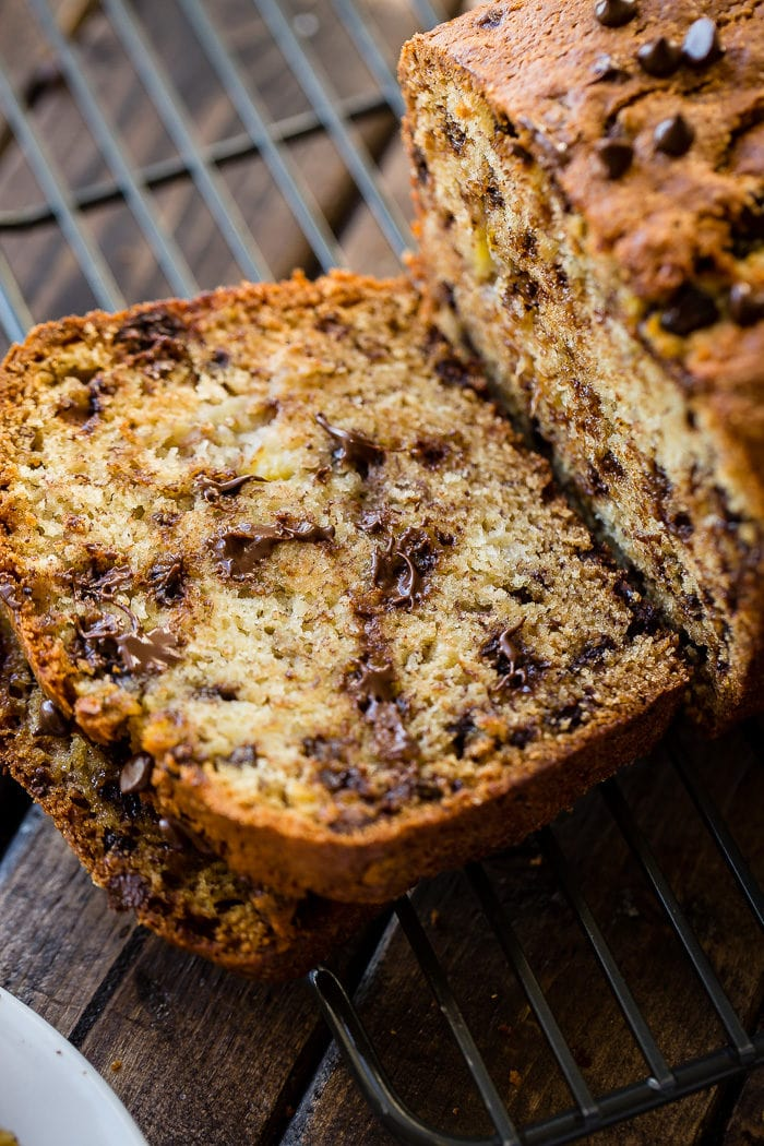 A tender loaf of chocolate chip banana bread cut in half