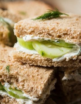 The best lemon dill cucumber sandwiches I've ever had added a touch of Greek yogurt to the spread. Try this awesome tea sandwich recipe at your next party! ohsweetbasil.com