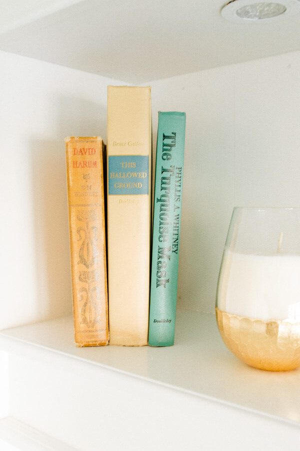 Use old books to add more feeling to a bookcase ohsweetbasil.com