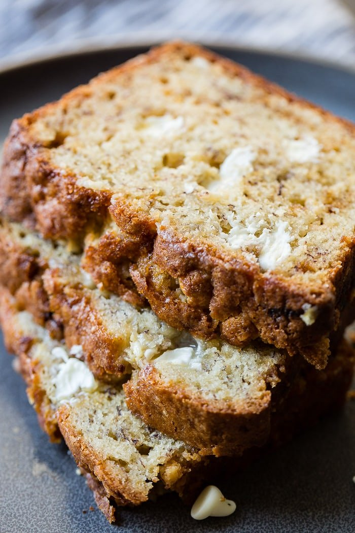 a stack of sliced white chocolate banana bread