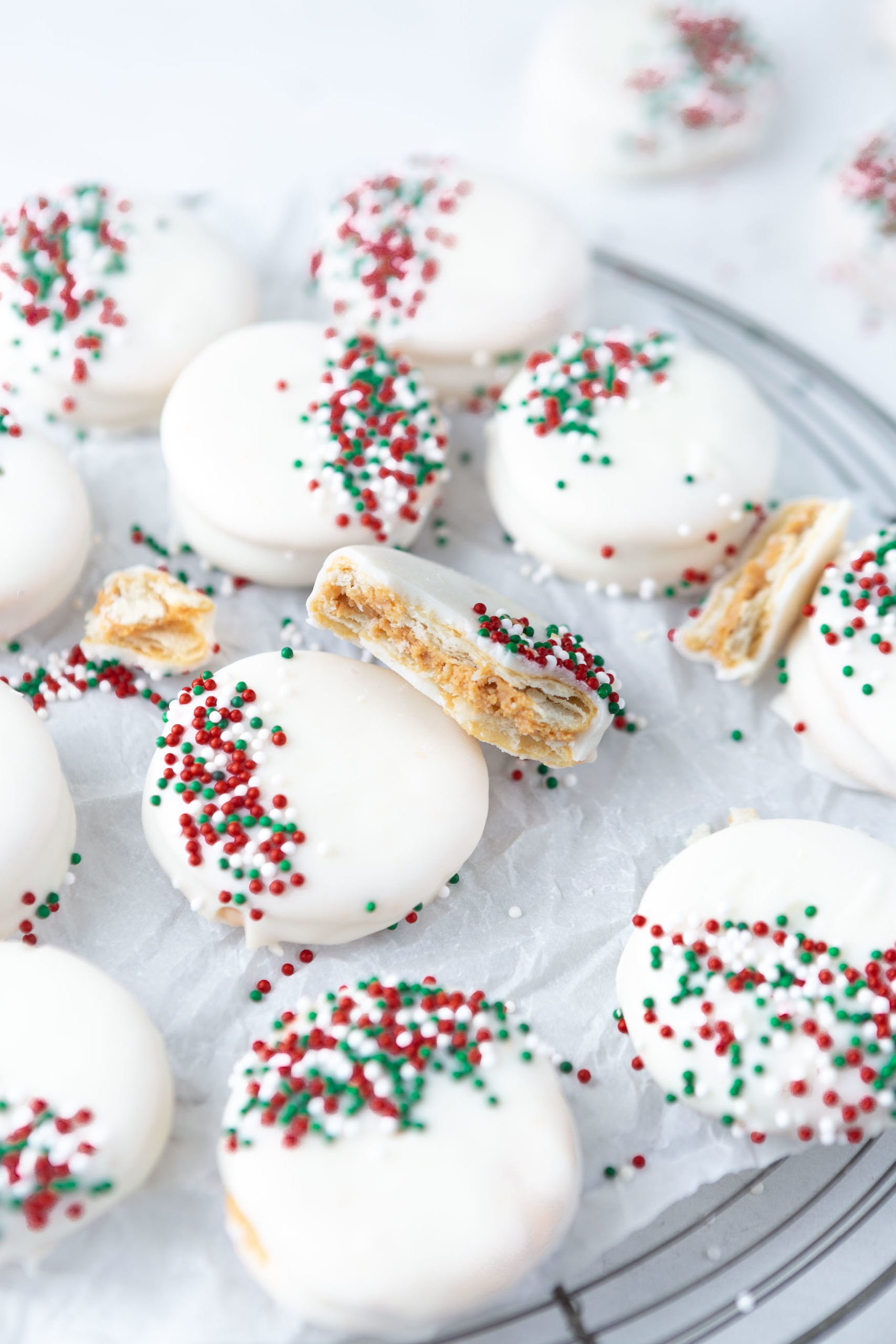 the easiest kid friendly holiday candy to make, peanut butter filled ritz crackers then dipped in white chocolate and sprinkles!