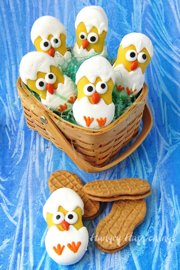 This Easter fill your baskets with these adorably cute Nutter Butter Hatching Chicks. Each white chocolate coated cookie is decorated to look like a baby chick popping it's head out to greet the world for the first time.